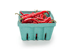 Chili Peppers in green container Royalty Free Stock Photography