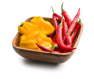 Chili peppers and habanero in wooden bowl Stock Images