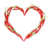 Chili peppers heart. Heart of small chili peppers isolated on a white background Stock Images