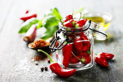 Chili peppers with herbs and spices Stock Photo