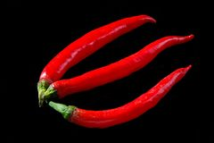 Chili peppers isolated on a black background. Royalty Free Stock Photography