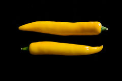 Chili peppers isolated on black background. Space yellow royalty free stock images