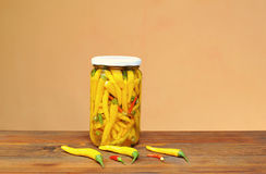 Chili peppers in a jar of glass Royalty Free Stock Photography
