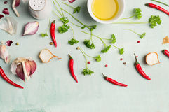 Chili peppers , oil, and fresh herbs and spices for cooking Stock Photography