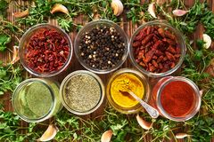 Various spices for dishes on wooden boards, camera from above stock photos