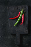 Chili peppers over black Royalty Free Stock Photo
