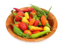 Chili peppers paprika in wooden dish stock photos