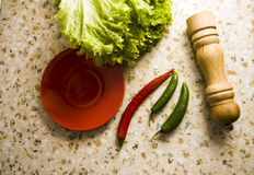 Chili peppers with pepper mill Royalty Free Stock Photo