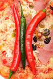 Chili peppers on pizza Royalty Free Stock Images