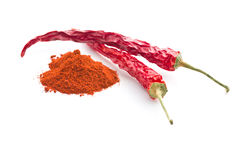 Chili peppers and powdered pepper. Stock Photos