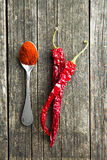Chili peppers and powdered pepper. royalty free stock photo