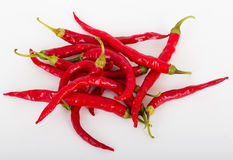 Chili peppers. Red hot chili peppers over white royalty free stock photos