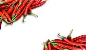 Chili Peppers rosso su bianco Fotografia Stock Libera da Diritti