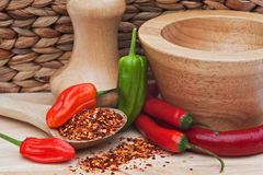 Chili peppers in rustic kitchen setting Stock Photo