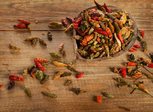 Chili peppers on a rustic wooden board Stock Photo