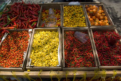 Chili peppers for sale. Closeup of colorful chili peppers for sales on market stall outdoors royalty free stock image
