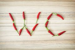 Chili peppers WC sign Stock Photography
