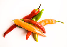 Chili Peppers on White. Colorful chili peppers on white background Royalty Free Stock Image