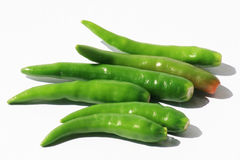 Chili peppers on white, Thailand. Green chili peppers on white, Thailand Stock Images