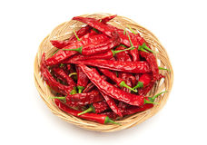 Chili peppers on the wicker dish Royalty Free Stock Photography