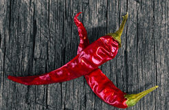 Chili peppers on wood Stock Photography