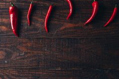 Chili peppers on a wooden background.  Stock Image