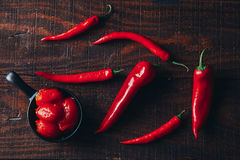 Chili peppers on a wooden background.  Stock Images