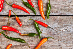 Chili peppers on wooden background. Royalty Free Stock Photo