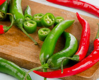 Chili Peppers on a wooden board Stock Image