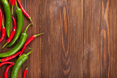 Chili peppers. On wooden table with copy space Stock Photography