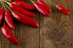 Chili peppers on a wooden table. Rustic Royalty Free Stock Photography