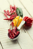 Chili peppes on wooden background Stock Photos