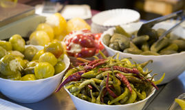 Chili and Pickles. Lots of plates of pickled food Stock Photos