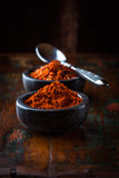 Chili powder and chili flakes Royalty Free Stock Image