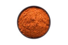 Chili powder in clay bowl isolated on white background. Seasonin Stock Image