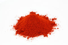 Chili Powder Heap On White Stock Photos