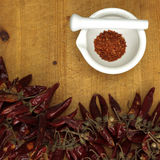 Chili powder in mortar with chillies, close-up Royalty Free Stock Image
