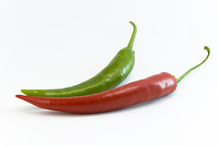 Chili red and green. Chilli peppers red and green on white background royalty free stock image