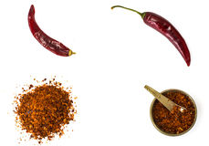 Chili, red pepper flakes, corns and chili powder Royalty Free Stock Images