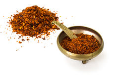 Chili, red pepper flakes, corns and chili powder Royalty Free Stock Photo
