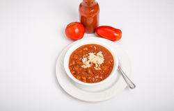Chili and Rice in White Bowl with Fresh Tomatoes Royalty Free Stock Photo