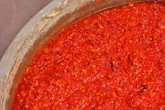 Chili sauce in the big jar, in the chili sauce factory Stock Image