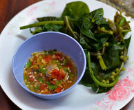 Chili sauce and blanching vegetables Stock Photos
