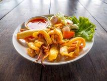 Chili sauce fried calamari seafood macro photo Royalty Free Stock Photography