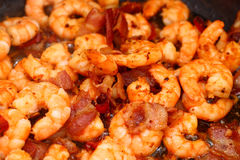 Chili shrimps with bacon Stock Photos