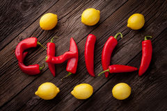 Chili sign with fresh chillies and lemons Stock Image