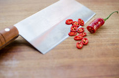 Chili. Sliced chili on a wooden board royalty free stock image
