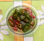 Chili. Some fresh chili peppers in olive oil stock images
