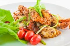 Chili stekt krabba med svart peper, bajsNim block Prik thailändska Dum, thailändsk skaldjur royaltyfria bilder