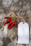 Chili with ticket Stock Photo